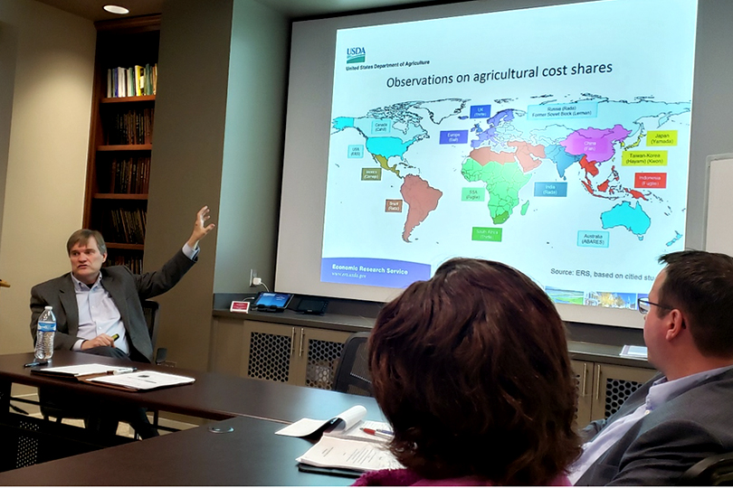 A photo of Keith Fuglie of USDA Economic Research Service sharing observations on agricultural cost shares.
